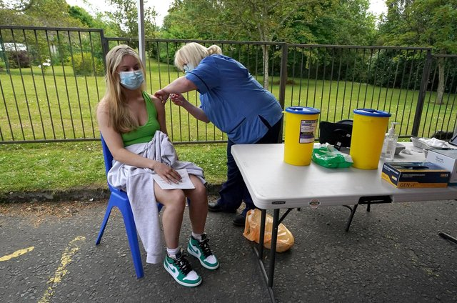 Vaccination Nurse Lorraine Mooney gives a vaccination to a member of the public outside a bus in the car park of Crieff Community Hospital.