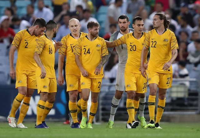 Martin Boyle (centre) and Jackson Irvine (far right) with their Australian international team-mates. Picture: Getty