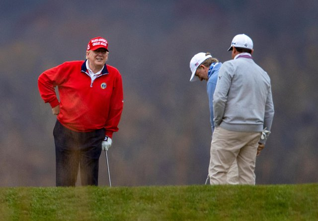 Donald Trump plays golf at the Trump National in Sterling, Virginia, on Friday (Picture: Tasos Katopodis/Getty Images)