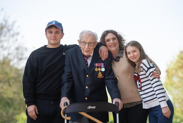 Then 99-year-old war veteran Captain Tom Moore, with (left to right) grandson Benji, daughter Hannah Ingram-Moore and granddaughter Georgia.