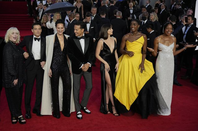 Billie Eilish, from left, Rami Malek, Phoebe Waller-Bridge, Cary Joji Fukunaga, Ana de Armas, Lashana Lynch and Naomie Harris pose for photographers upon arrival for the World premiere of the new film from the James Bond franchise 'No Time To Die', in London Tuesday, Sept. 28, 2021. (AP Photo/Matt Dunham)