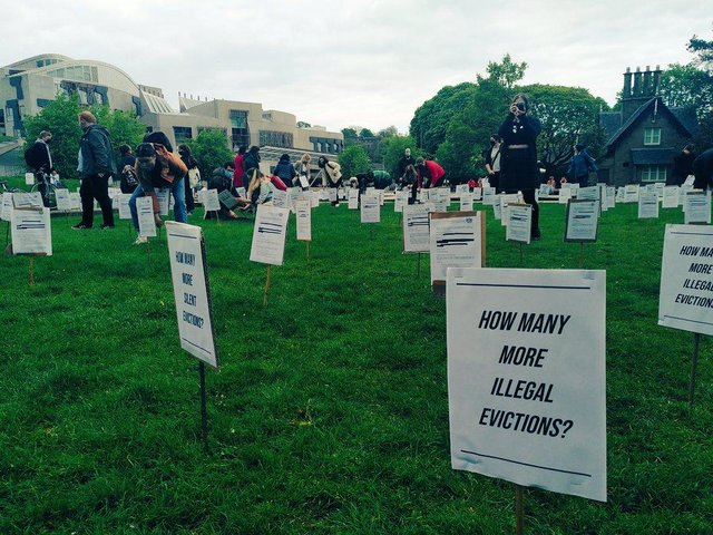 Eviction orders planted in the ground by Living Rent members as part of their protest at Holyrood yesterday.