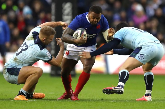 Virimi Vakatawa of France is tackled by Chris Harris (L) and Sam Johnson during last year's Six Nations match against Scotland. The sides will meet against on March 26. Picture: David Rogers/Getty Images