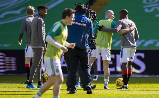 Celtic's Scott Brown, left, embraces Rangers' Glen Kamara before the game between Celtic and Rangers on Sunday (Picture: Craig Williamson/SNS Group)