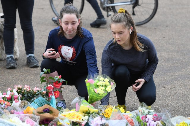 People leave floral tributes at the bandstand on Clapham Common, London, for Sarah Everard. A serving police constable has been charged with kidnapping and murdering the 33-year-old marketing executive (Picture: Kirsty O'Connor/PA)