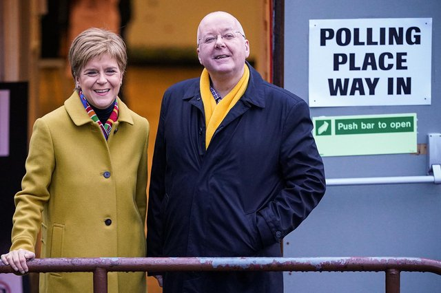 Nicola Sturgeon votes with her husband Peter Murrell at Broomhouse Community Hall in Ballieston on December 2019, in Glasgow, Scotland. (Photo by Jeff J Mitchell/Getty Images)