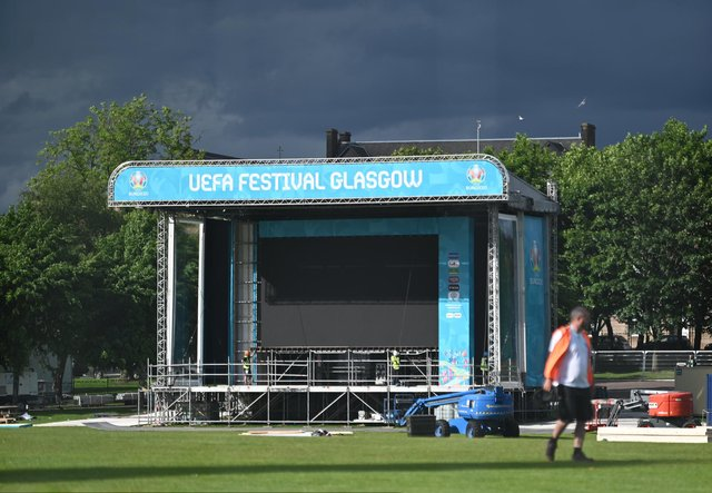 John Devlin 04/06/2021. GLASGOW. Glasgow Green. The Fan Zone for EURO 2020 is being built as preparations are ramped up ahead of kick off. A giant tv screen is installed for fans. Banners have been installed around the city and are seen here in Buchanan Street.