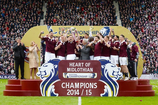 The Hearts players celebrate as they lift the Scottish Championship trophy after a 2-2 draw with Rangers at Tynecastle on May 2, 2015.